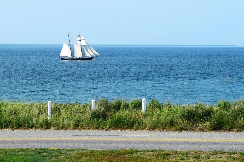 Tall Ship off the Coast of a Cape Cod, Massachusetts bluff